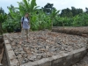 Volunteer, Mandy, standing on the foundation of the first building!